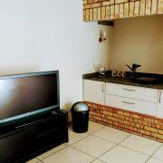 Open plan lounge kitchenette
